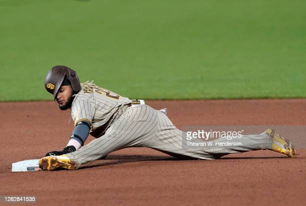 Fernando Tatis Jr #23 of the San Diego Padres steals second base against the San Francisco Giants in the top of the seventh inning at Oracle Park on...