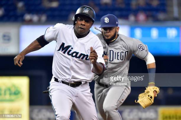 Fernando Tatis Jr #23 of the San Diego Padres tags Curtis Granderson of the Miami Marlins during a run down in the seventh inning of the game at...
