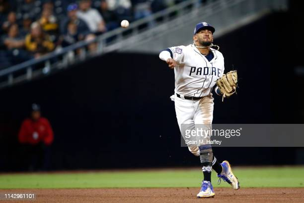Fernando Tatis Jr #23 of the San Diego Padres throws out Trevor Story of the Colorado Rockies during the eighth inning of a game at PETCO Park on...