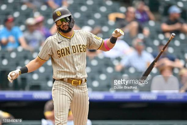 Fernando Tatis Jr. #23 of the San Diego Padres tosses his bat after hitting a third inning solo homerun against the Colorado Rockies at Coors Field...