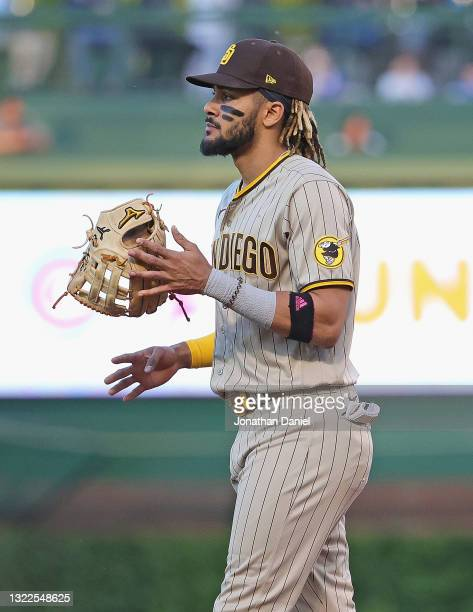 Fernando Tatis Jr. #23 of the San Diego Padres twirls his glove as he moves to his position against the Chicago Cubs at Wrigley Field on June 01,...