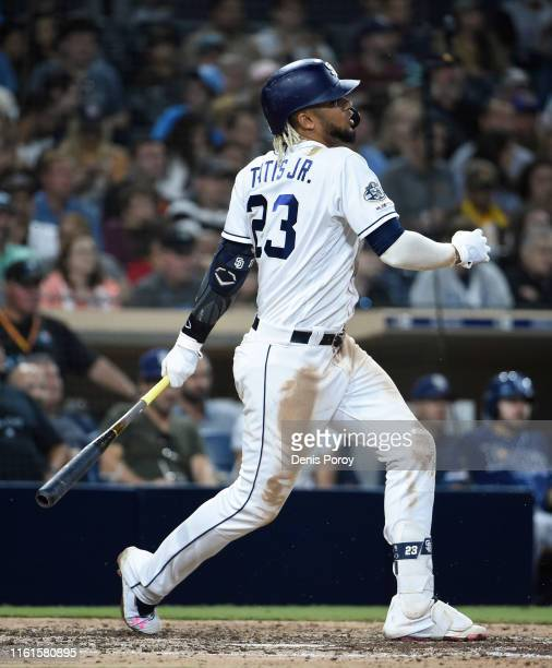 Fernando Tatis Jr #23 of the San Diego Padres twists as he swings during the sixth inning of a baseball game against the Tampa Bay Rays at Petco Park...