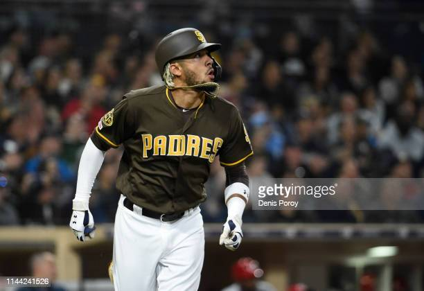 Fernando Tatis Jr #23 of the San Diego Padres watches the flight of his a solo home run during the third inning of a baseball game against the...