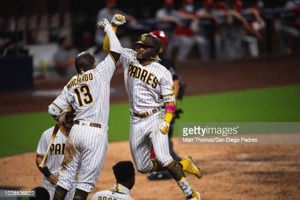 Fernando Tatis Jr celebrates with Manny Machado of the San Diego Padres after hitting a home run in the bottom of the seventh inning against the St...