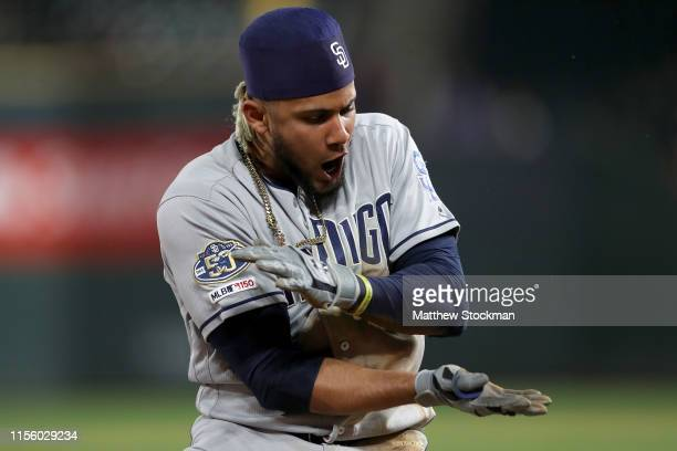 Fernando Tatis Jr of the San Diego Padres celebrates after hitting a triple in the 12th inning against the Colorado Rockies at Coors Field on June 14...