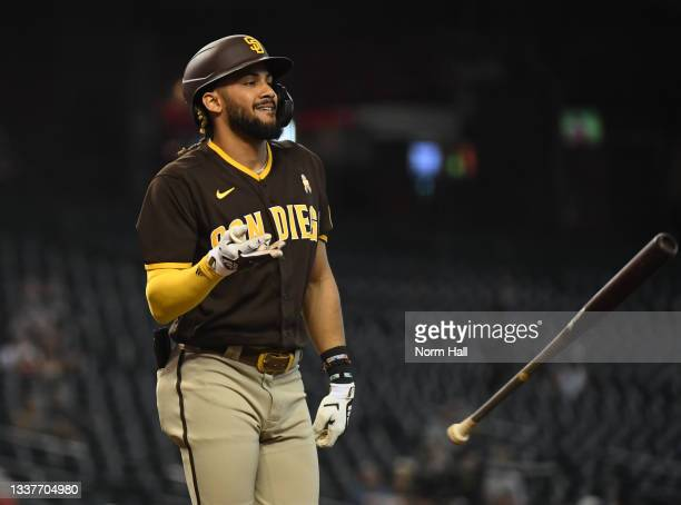Fernando Tatis Jr of the San Diego Padres throws his bat after being called out on strikes against the Arizona Diamondbacks during the fourth inning...
