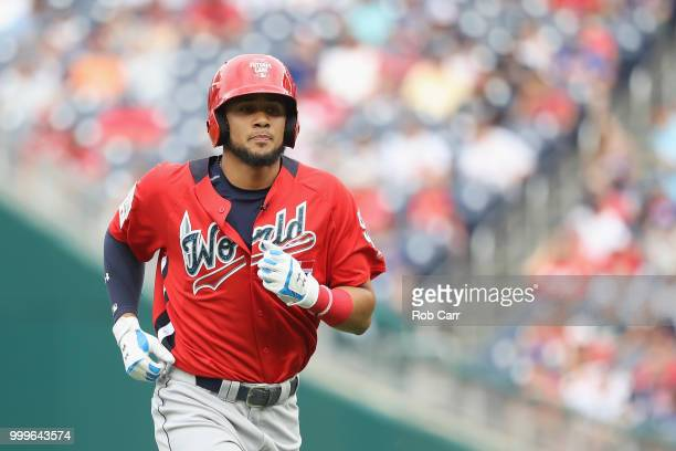 Fernando Tatis of the San Diego Padres and the World Team flies out against the US Team during the SiriusXM AllStar Futures Game at Nationals Park on...