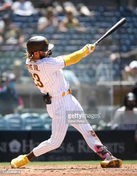 Fernando Tatís Jr. #23 of the San Diego Padres hits a solo home run during the fourth inning of a baseball game against the Colorado Rockies at Petco...