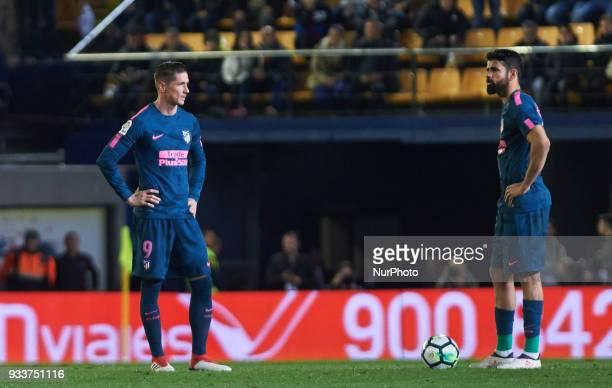 Fernando Torres and Diego Costa of Atletico de Madrid reacts after goal of Villarreal during the La Liga match between Villarreal and Atletico de...