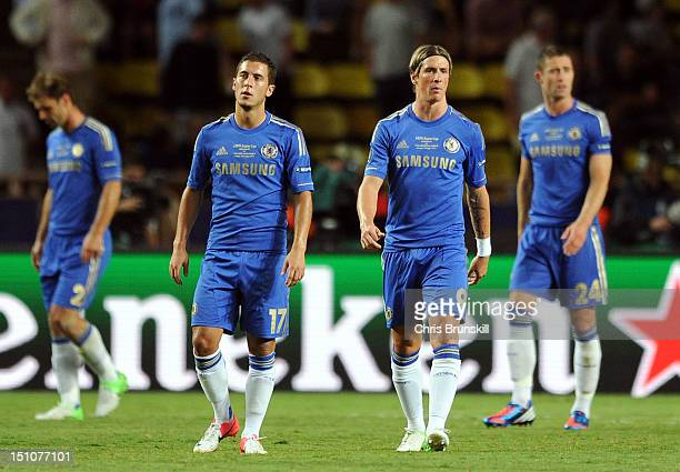 Fernando Torres and Eden Hazard of Chelsea look dejected following Atletico Madrid's fourth goal during the UEFA Super Cup match between Chelsea and...