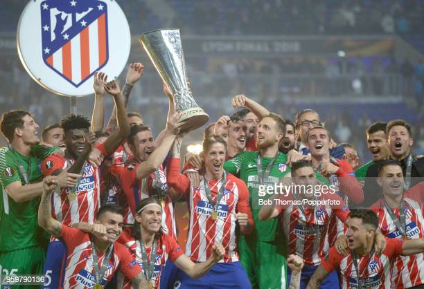 Fernando Torres and Gabi and the Atletico Madrid team celebrate with the trophy after the UEFA Europa League Final between Olympique de Marseille and...