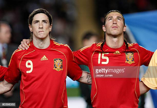 Fernando Torres and Sergio Ramos of Spain listen to their countries national anthoms during the international friendly match between Spain and Italy...