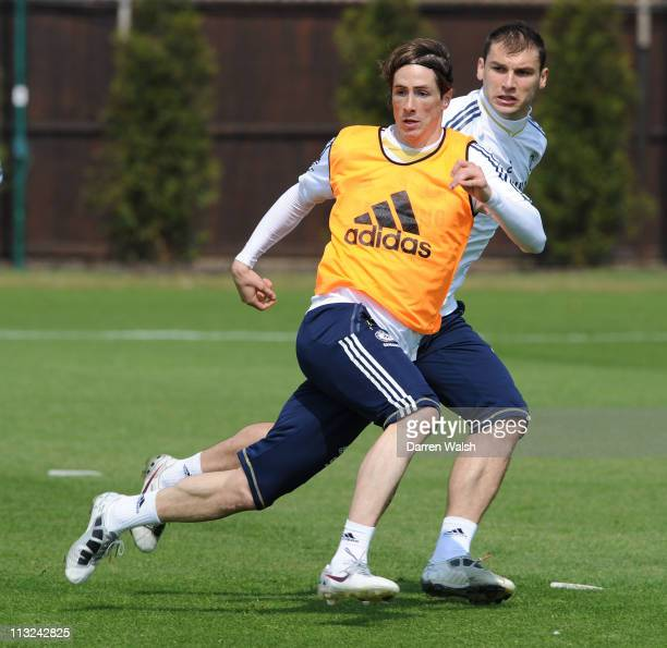 Fernando Torres, Branislav Ivanovic of Chelsea during a training session at the Cobham training ground on April 28, 2011 in Cobham, England.