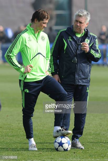 Fernando Torres Carlo Ancelotti of Chelsea during a training session at the club's training facility in Cobham on March 15 2010 Chelsea are set to...