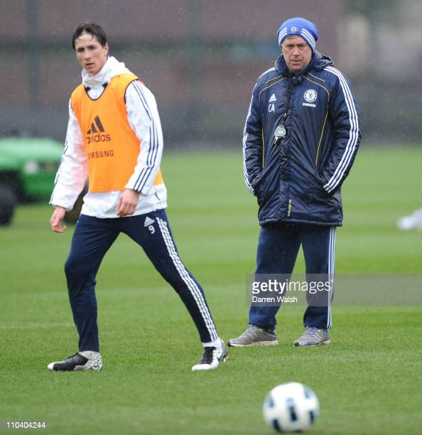 Fernando Torres, Carlo Ancelotti of Chelsea during a training session at the Cobham training ground on March 18, 2011 in Cobham, England.
