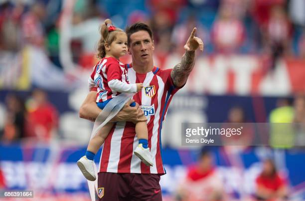 Fernando Torres carries his daughter Elsa at the end of the La Liga match between Club Atletico de Madrid and Athletic Club Bilbao at Vicente...
