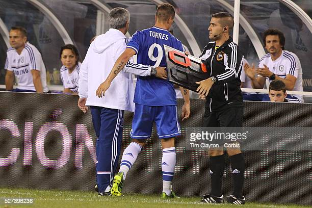 Fernando Torres Chelsea is replaced by Romelu Lukaku as coach Jose Mourinho congratulates him during the Chelsea V AC Milan Guinness International...