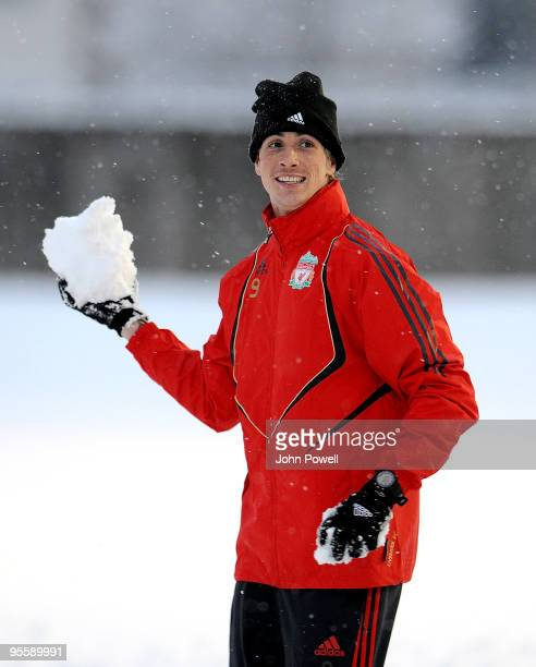Fernando Torres enjoys the snowfall during a training session at Melwood Training Ground on January 5 2010 in Liverpool England
