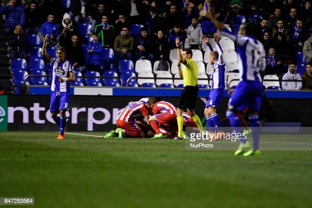 Fernando Torres forward of Atletico de Madrid falls unconscious on the ground after a blow with Alex Bergantiños of Deportivo de La Coruña during the...
