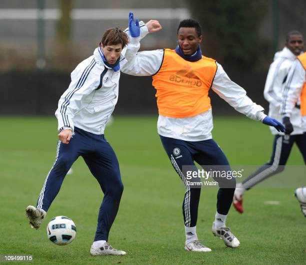 Fernando Torres John Mikel Obi of Chelsea during a training session at the Cobham Training ground on February 28 2011 in Cobham England