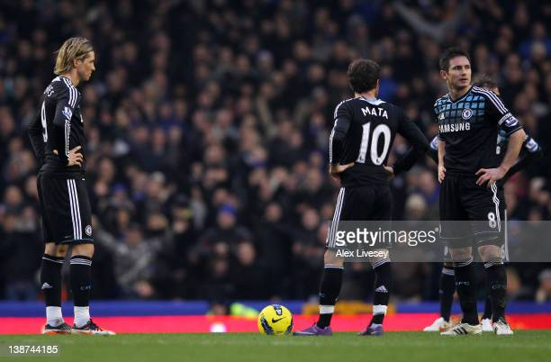 Fernando Torres Juan Mata and Frank Lampard of Chelsea look dejected after Everton scored their second goal during the Barclays Premier League match...