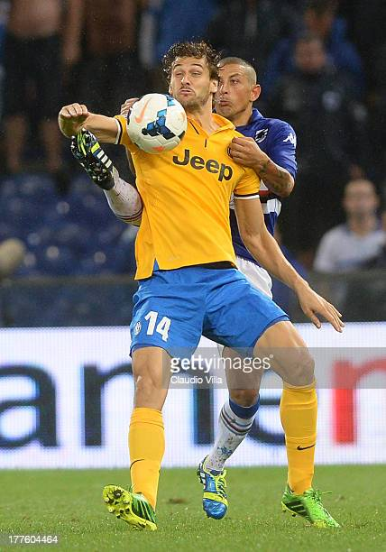 Fernando Torres Llorente of Juventus and Angelo Palombo of UC Sampdoria compete for the ball during the Serie A match between UC Sampdoria and...