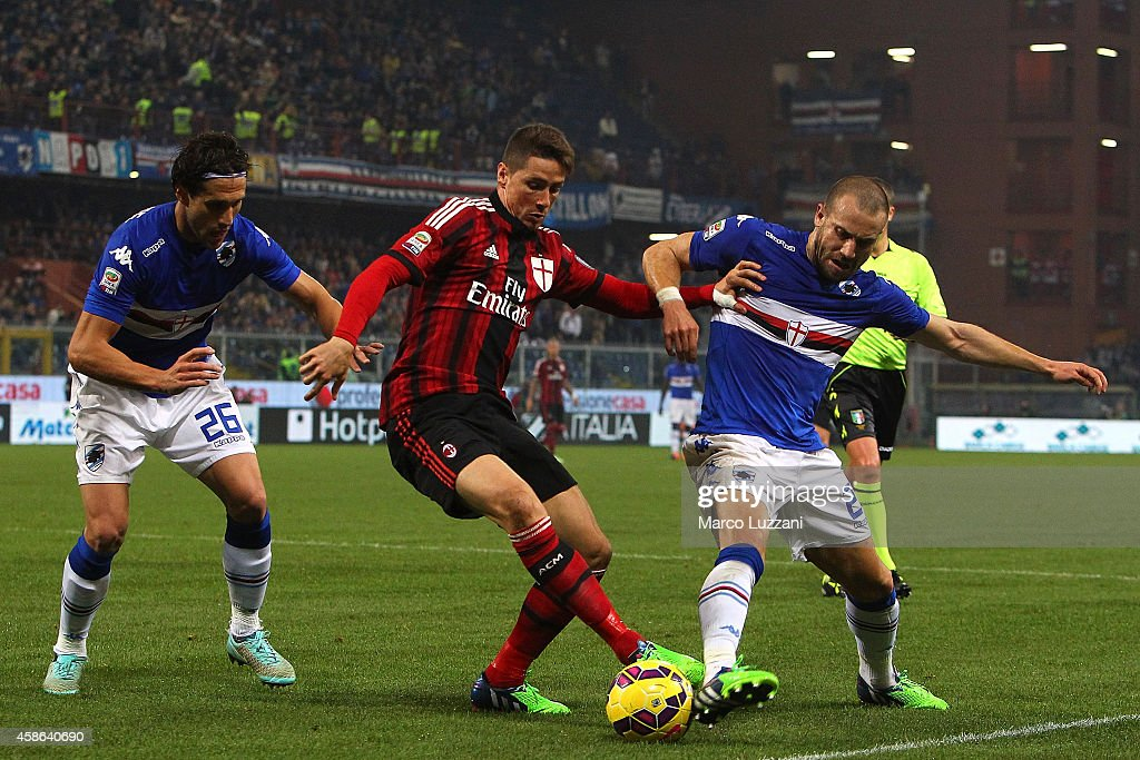 Fernando Torres (C) of AC Milan competes for the ball with Matias Agustin Silvestre (L) and Lorenzo De Silvestri (R) of UC Sampdoria during the Serie A match between UC Sampdoria and AC Milan at Stadio Luigi Ferraris on November 8, 2014 in Genoa, Italy.
