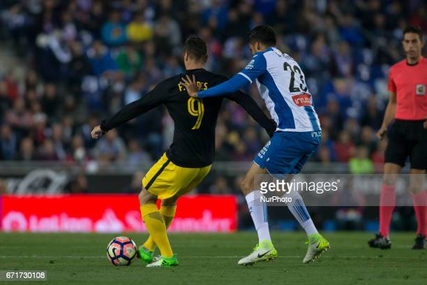 Fernando Torres of Athletico de Madrid defended by Diego Reyes of RCD Espanyol during the Spanish championship La Liga match between RCD Espanyol vs...