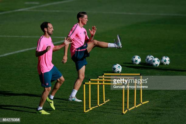 Fernando Torres of Atletico de Madrid and his teammate Juan Francisco Torres alias Juanfran excersise during a training session on the eve of the...