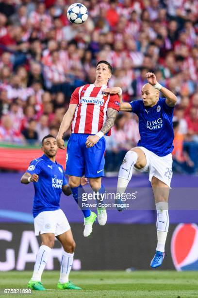 Fernando Torres of Atletico de Madrid battles for the ball with Yohan Benalouane of Leicester City during their 201617 UEFA Champions League...