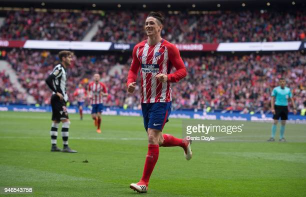 Fernando Torres of Atletico de Madrid celebrates after scoring his teamÕs third goal during the La Liga match between Atletico Madrid and Levante at...