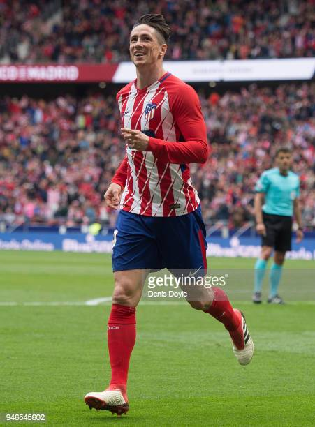 Fernando Torres of Atletico de Madrid celebrates after scoring his team's third goal during the La Liga match between Atletico Madrid and Levante at...