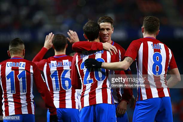 Fernando Torres of Atletico de Madrid celebrates his teammate's Juan Francisco Torres alias Juanfran goal during the Copa del Rey Round of 16 match...
