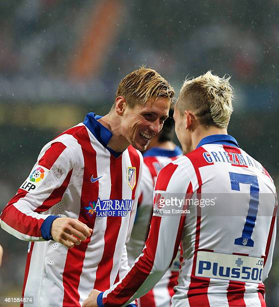 Fernando Torres of Atletico de Madrid celebrates with Antoine Griezmann after scoring his second goal during the Copa del Rey round of 16 second leg...