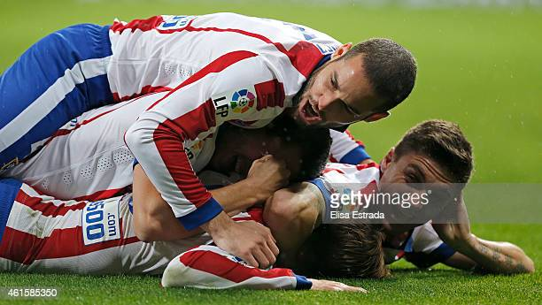 Fernando Torres of Atletico de Madrid celebrates with Siqueira and Mario Suarez after scoring his second goal during the Copa del Rey round of 16...