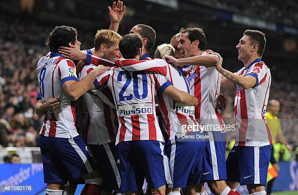 Fernando Torres of Atletico de Madrid celebrates with team mates after scoring Atletico's opening goal during the Copa del Rey Round of 16 Second leg...