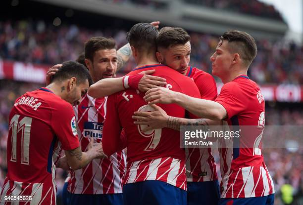 Fernando Torres of Atletico de Madrid celebrates with teammates after scoring his team's third goal during the La Liga match between Atletico Madrid...