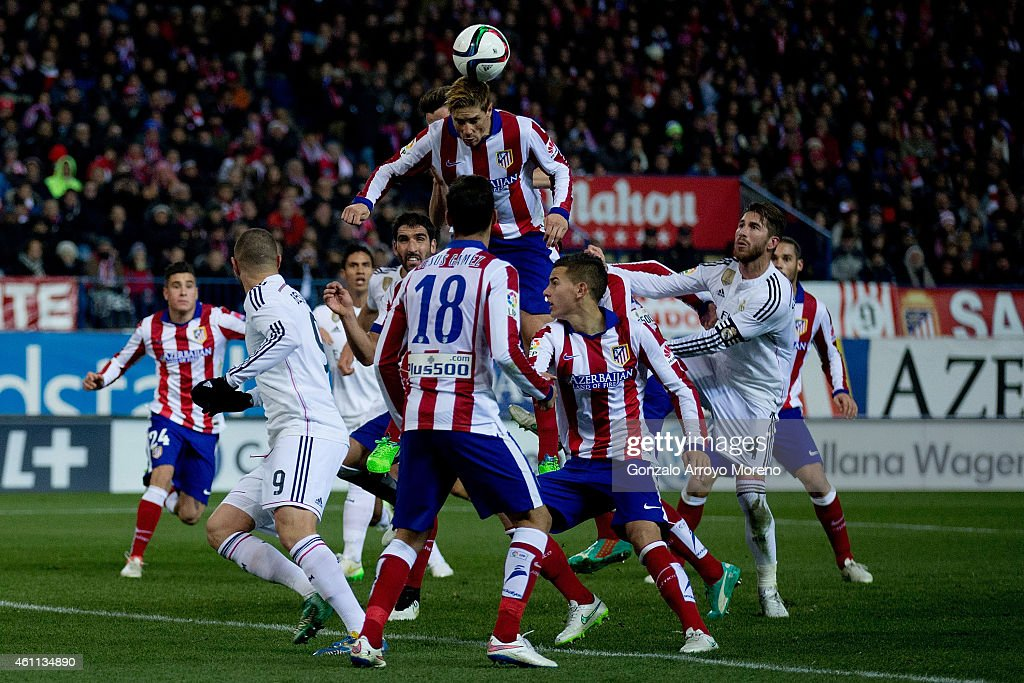 Fernando Torres of Atletico de Madrid clears the ball during the Copa del Rey Round of 16 first leg match between Club Atletico de Madrid and Real Madrid CF at Vicente Calderon Stadium on January 7, 2015 in Madrid, Spain.