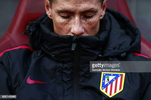 Fernando Torres of Atletico de Madrid closes his eyes as he reacts on the bench prior to start the La Liga match between Club Atletico de Madrid and...