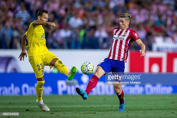 Fernando Torres of Atletico de Madrid competes for the ball with Daniel Castello of UD Las Palmas during the La Liga match between Club Atletico de...
