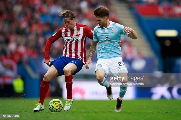 Fernando Torres of Atletico de Madrid competes for the ball with Carles Planas of RC Celta de Vigo during the La Liga match between Club Atletico de...