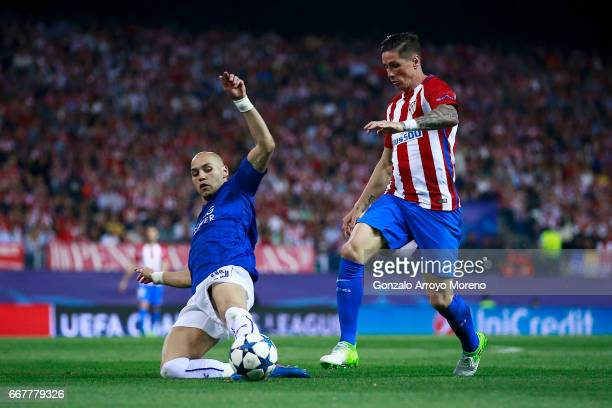 Fernando Torres of Atletico de Madrid competes for the ball with Yohan Benalouane of Leicester City FC during the UEFA Champions League Quarter Final...