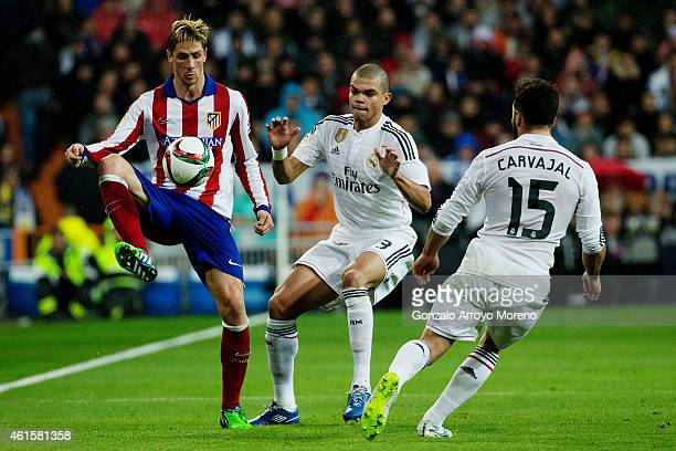 Fernando Torres of Atletico de Madrid competes for the ball with Pepe of Real Madrid CF during the Copa del Rey Round of 16 second leg match between...