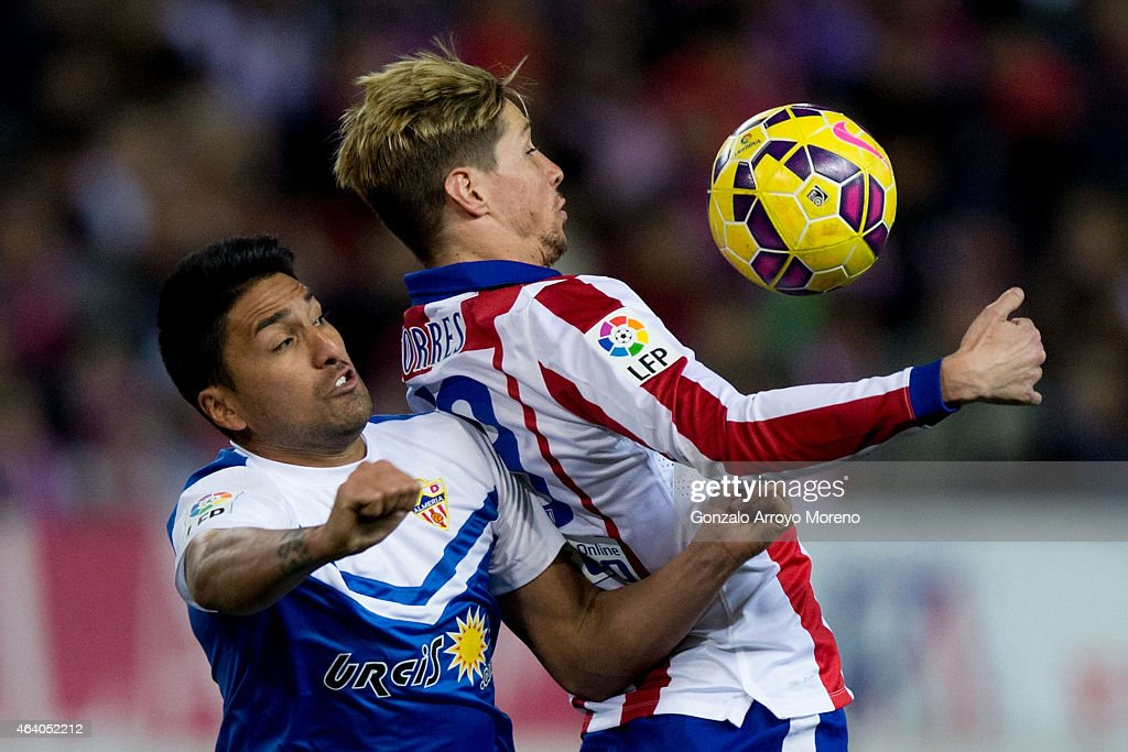 Fernando Torres (R) of Atletico de Madrid competes for the ball with Mauro Javier Dos Santos (L) of Almeria UD during the La Liga match between Club Atletico de Madrid and UD Almeria at Vicente Calderon Stadium on February 21, 2015 in Madrid, Spain.