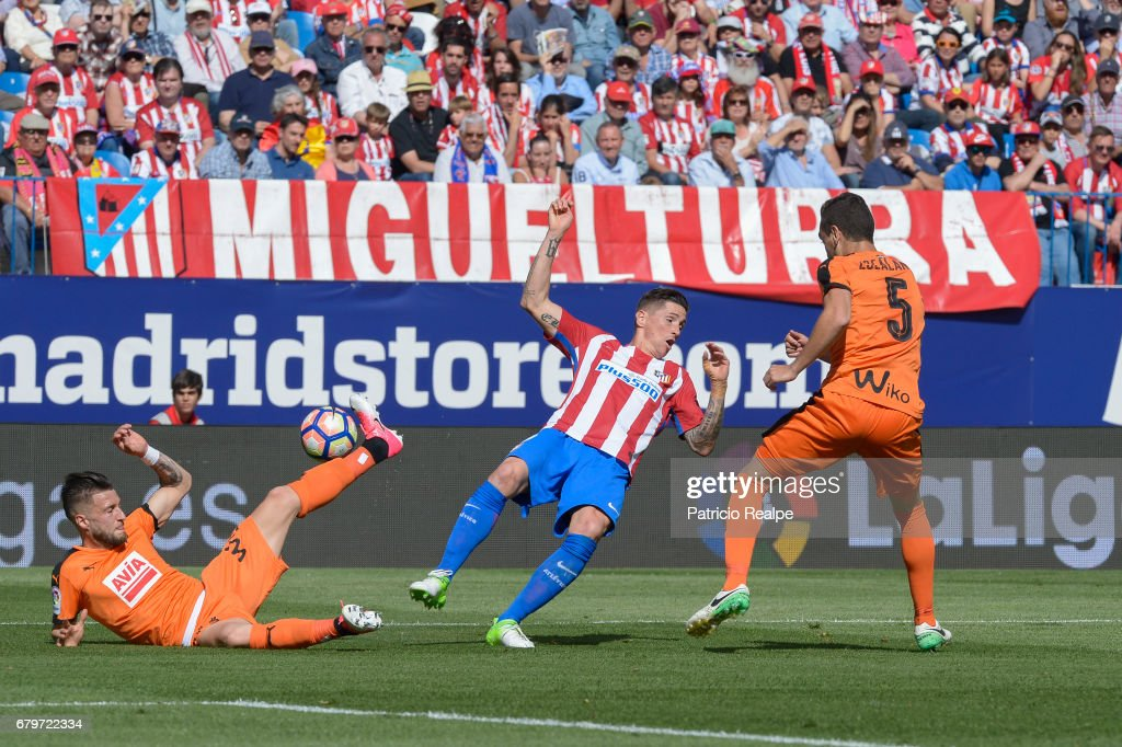Fernando Torres of Atletico de Madrid falls as David Junca of Eibar controls the ball from the ground during a match between Club Atletico Madrid and SD Eibar as part of La Liga 2017 at Vicente Calderon Stadium on May 06, 2017 in Madrid, Spain.