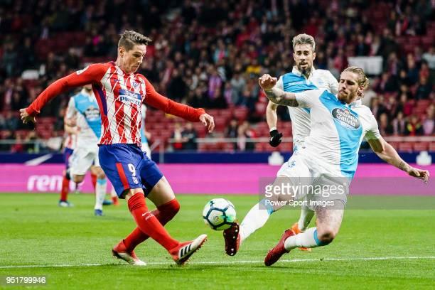 Fernando Torres of Atletico de Madrid fights for the ball with Raul Albentosa Redal of Deportivo La Coruna during the La Liga 201718 match between...