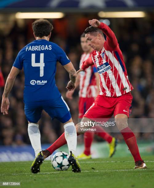 Fernando Torres of Atletico Madrid and Cesc Fabregas of Chelsea in action during the UEFA Champions League group C match between Chelsea FC and...