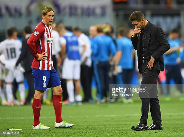 Fernando Torres of Atletico Madrid and Head coch Diego Simeone are seen during the UEFA Champions League Final match between Real Madrid and Club...