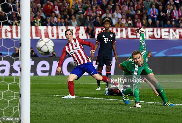 Fernando Torres of Atletico Madrid beats Manuel Neuer of Bayern Munich but hits the post during the UEFA Champions League semi final first leg match...