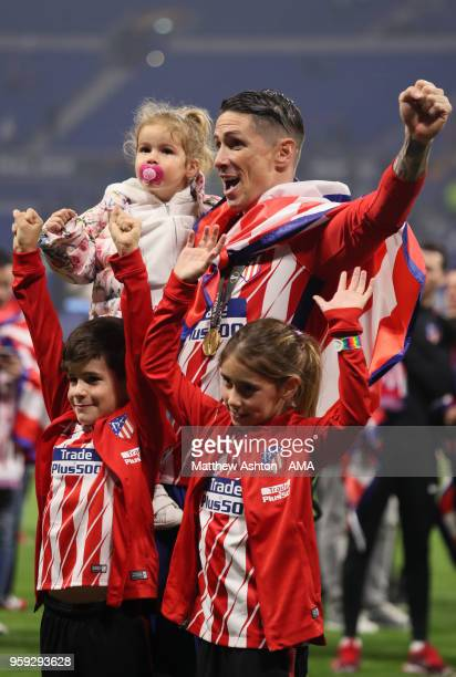 Fernando Torres of Atletico Madrid celebrates with his children at the end of the UEFA Europa League Final between Olympique de Marseille and Club...